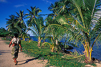 Samoan walks along the main track on Manono Island, Samoa