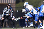 08 February 2015: Duke's Jack Rowe (left) chases a loose ball. The Duke University Blue Devils hosted the United States Air Force Academy Falcons at Koskinen Stadium in Durham, North Carolina in a 2015 NCAA Division I Men's Lacrosse match. Duke won the game 13-7.