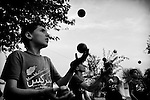 Young boys practice their juggling skills at the Mobile Mini Circus for Children, Jalalabad 01 October 2013 (John D McHugh)
