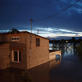 DOBRZYKOW, POLAND, MAY 24, 2010:.One of the flooded houses at dusk..The latest chapter of disastrous floods in Poland has been opened yesterday, May 23, 2010, after Vistula river broke its banks and flooded over 25 villages causing evacualtion of most inhabitants..Photo by Piotr Malecki / Napo Images..DOBRZYKOW, POLSKA, 24/05/2010:.Jeden z zatopionych domow . Najnowszy akt straszliwych tegorocznych powodzi zostal rozpoczety wczoraj gdy Wisla przerwala waly na wysokosci wsi Swiniary kolo Plocka..Fot: Piotr Malecki / Napo Images ..