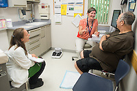 Amanda Dauten, class of 2015, from left, Alicia Jacobs, M.D., patient, release 20130725001, at Colchester Family Practice.