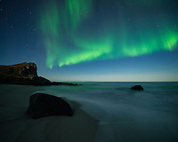 Northern lights in sky over Myrland beach, Flakstadøy, Lofoten Islands, Norway