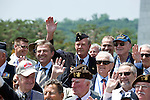 Korean War veteran Ernest Moscrop joins other veterans for a group photo after taking part in a commemorative event to mark the 60th anniversary of the start of the Korean War at the National Cemetery in Seoul, South Korea on 23 June, 2010..Photographer: Rob Gilhooly