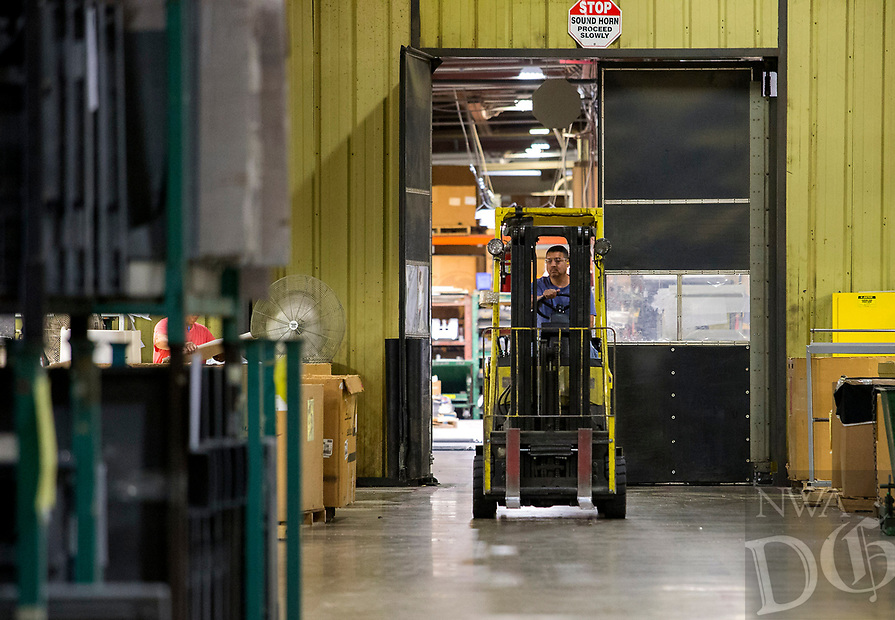 NWA Democrat-Gazette/JASON IVESTER<br /> Juan Yanez naviages the floor in a forklift Wednesday, May 10, 2017, at FM Corporation in Rogers.
