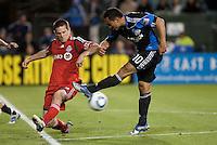 Arturo Alvarez (10) kicks the ball against Sam Cronin (left). Toronto FC defeated the San Jose Earthquakes 3-1 at Buck Shaw Stadium in Santa Clara, California on May 29th, 2010.