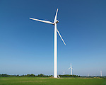 Wind turbine generators in a green field. Southern Ontario, Canada.