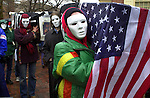 Protesters wear masks and carry a coffin draped with an American Flag during a protest against war with Iraq, March 20, 2003, in Philadelphia, Pennsylvania. The protestors blocked the entrances to the Federal Courthouse, and demanded that the U.S. pull out of Iraq. 80 protesters were arrested on federal charges. (Photo by William Thomas Cain/photodx.com)