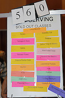 New York, NY, USA - June 23, 2012: Sold out classes at the OrigamiUSA convention posted on a bulletin board. Attendees from all over the USA take classes in how to fold the various Origami designs, from simple to highly complex.  With many of the popular classes limited to under 20 students, tickets are in demand and attendees eagerly look for a model that they wish to learn to fold then try to get a ticket for the class.