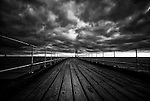 Wooden pier at Whitby under dark skies, England