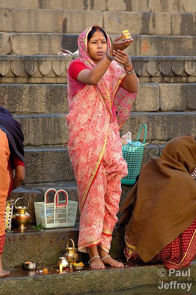 Indians worship alongside the Ganges River at Varanasi, a sacred site for Hindus.