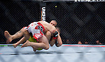 Ricardo Lamas takes down Cub Swanson in a featherweight match during Saturday's UFC on Fox event at the Honda Center.