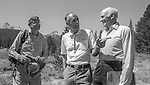 "Tuolumne Meadows, August 24, 1985:  Dr. Michael Adams, Secretary of the Interior Don Hodel and U.S. Senator Alan Cranston, (D California).  Mount Ansel Adams, an 11,700 foot peak in a remote section of Yosemite National Park was dedicated Saturday, August 24, 1985, in a ceremony recognizing the famed photographer for his contribution to the American conservation movement. Adams was eulogized as a man who dedicated his life to photography and the preservation of planet Earth. The dedication ceremony was led by Adams' son, Dr. Michael Adams of Fresno, and attended by Adams' widow, Virginia Adams, Secretary of the Interior Donald Hodel, Sen. Alan Cranston, D-California, National Park Service Director William Penn Mott, actor Robert Redford, and other environmental and conservation leaders. In 1932, Ansel Adams and several Sierra Club companions first climbed the peak, according to Virginia Adams, who added that ""Ansel loved its tower shape. He called it 'The Tower' on the Lyell Fork of the Merced River. After they came down from climbing it, they sat around the campfire and one of them suggested that they name it Mount Ansel Adams."" Informally, that is what the Sierra Club did, calling the peak Mount Ansel Adams in the Sierra Club Guide until 53 years later the peak was finally officially named.  Photo by Al Golub/Golub Photography"
