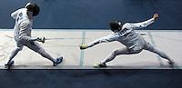 European Championships Fencing 2010 / Fecht Europameisterschaft 2010 in Leipzig - Competition Championat d'europe - im Bild: battle Jörg Fiedler (GER) against Gabor Boczko (HUN, left) . Foto: Norman Rembarz..Norman Rembarz , Autorennummer 41043728 , Augustenstr. 2, 04317 Leipzig, Tel.: 01794887569, Hypovereinsbank: BLZ: 86020086, KN: 357889472, St.Nr.: 231/261/06432 - Jegliche kommerzielle Nutzung ist honorar- und mehrwertsteuerpflichtig! Persönlichkeitsrechte sind zu wahren. Es wird keine Haftung übernommen bei Verletzung von Rechten Dritter. Autoren-Nennung gem. §13 UrhGes. wird verlangt. Weitergabe an Dritte nur nach  vorheriger Absprache..