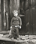 3 year old boy in front of barn shed. 1974
