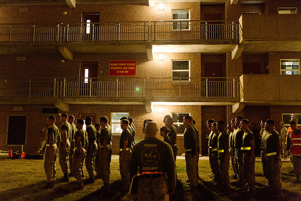 October 22, 2014. Camp LeJeune, North Carolina.<br />  Marines in the Ground Combat Element Integrated Task Force line up in front of their barracks. As part of the training for the GCEITF, each Marine must finish the Combat Fitness Test (GFT), which includes a half mile run, followed by a series of tests that simulate conditions they could encounter in combat situations.<br />  The Ground Combat Element Integrated Task Force is a battalion level unit created in an effort to assess Marines in a series of physical and medical tests to establish baseline standards as the Corps analyze the best way to possibly integrate female Marines into combat arms occupational specialities, such as infantry personnel, for which they were previously not eligible. The unit will be comprised of approx. 650 Marines in total, with about 400 of those being volunteers, both male and female. <br />  Jeremy M. Lange for the Wall Street Journal<br /> COED