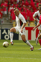 Clint Mathis dribbles the ball. The USA tied South Korea, 1-1, during the FIFA World Cup 2002 in Daegu, Korea.