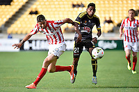Roy Krishna and Jason Hoffman in action during the A League - Wellington Phoenix v Melbourne City at Westpac Stadium, Wellington, New Zealand on Sunday 30 November 2014.