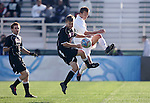 New Mexico's Ben Ashwill (2) tries to block a clearance by Maryland's David Glaudemans (r). The University of Maryland Terrapins defeated the University of New Mexico Lobos 1-0 in the Men's College Cup Championship game at SAS Stadium in Cary, NC, Friday, December 11, 2005.