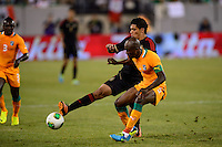 Mexico forward Raul Jimenez (9) is marked by Ivory Coast defender Didier Zokora (5). Mexico defeated the Ivory Coast 4-1 during an international friendly at MetLife Stadium in East Rutherford, NJ, on August 14, 2013.