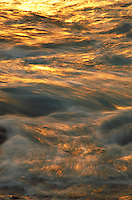 Ocean at sunset, slow shutter speed showing wave motion