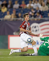New England Revolution goalkeeper Preston Burpo (24) denies Chivas USA forward Justin Braun (17). Chivas USA defeated the New England Revolution, 4-0, at Gillette Stadium on May 5, 2010.