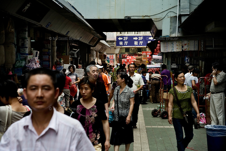 People walk through a wholesale market near the Fuzi Miao area of Nanjing, Jiangsu, China.  This market supplies consumer goods to smaller markets and shops in the rest of the city.