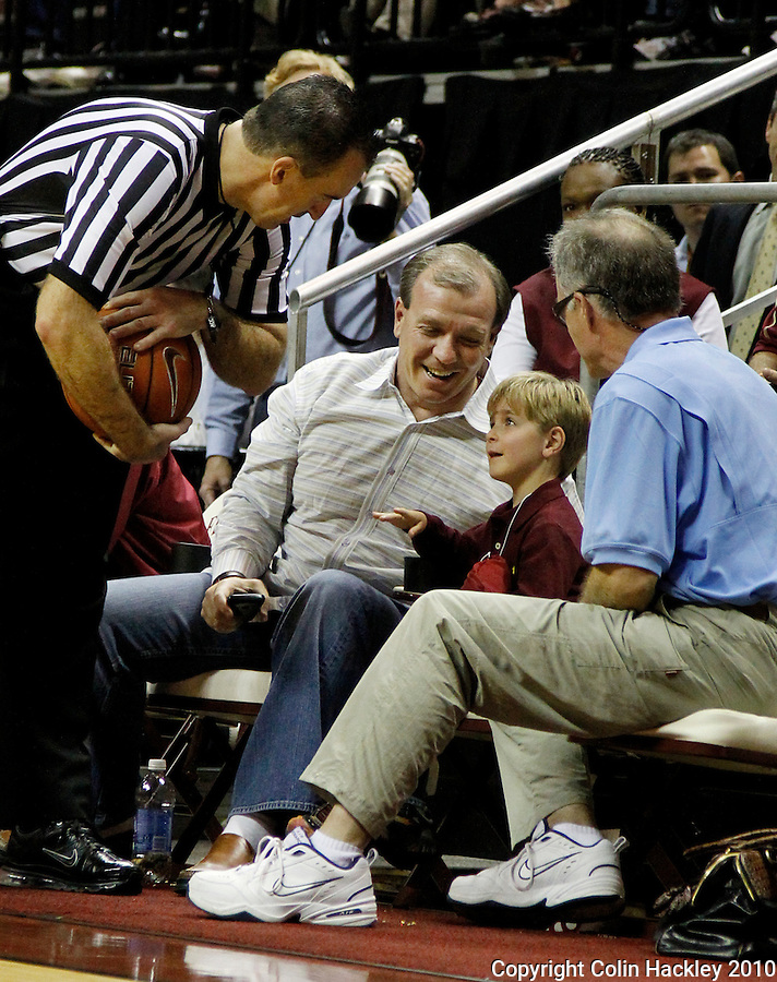 TALLAHASSEE, FL 2/1/11-FSU-WF MBB11 CH-A referee checks on Ethan Fisher, center, son of Florida State Football Coach Jimbo Fisher after a Wake Forest landed on him during first half action Tuesday at the Donald L. Tucker Center in Tallahassee...COLIN HACKLEY PHOTO