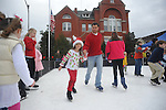 Warren Johnson and his daughter Josie skate on synthetic ice in Oxford, Miss. on Saturday, December 15, 2012.