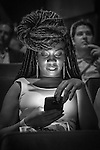 "Bellmore, New York, USA. July 21, 2016. Actress CASSANDRA B WARD, co-writer of Short Film award-winner ""Reset"" - in audience before start of the 19th Annual Long Island International Film Expo Awards Ceremony, LIIFE 2016, held at the historic Bellmore Movies. LIIFE was called one of the 25 Coolest Film Festivals in the World by MovieMaker Magazine. (Black and White)"
