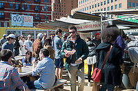 The Dekalb Market in downtown Brooklyn in New York is seen on the seasons opening day, Saturday, April 7, 2012.  The market, which uses decorated and modified shipping containers as kiosks for its vendors, is located in the high density area of downtown Brooklyn and includes vendors selling food, clothing and accessories, all from local sellers. The market is the product of Urban Space, which has over 20 container projects in London and produces temporary Christmas holiday markets in parks in New York.  (© Richard B. Levine)