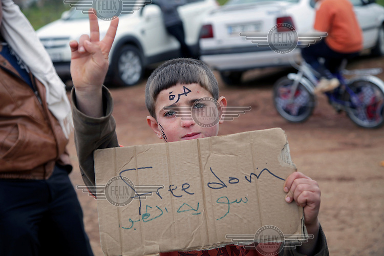 Syrian refugees demonstrating against the Assad regime outside their camp in south west Turkey where more than 1300 people have arrived over a few days, fleeing from an ongoing Syrian Army offensive in Idlib.