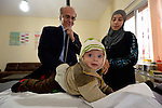 Dr. Husein Mady examines a Syrian refugee child in a clinic in Kamd El Loz, in Lebanon's Bekaa Valley. Run by the Amel Association, the clinic's work with refugees is supported by International Orthodox Christian Charities, a member of the ACT Alliance..