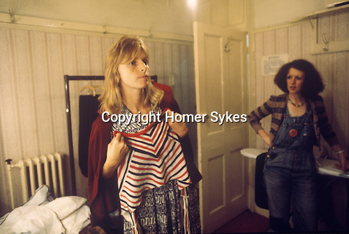 """Linda McCartney Wing Tour 1973. Wardrobe designer Linda chooseing clothes to wear. 1970s UK The photographs from this set were taken in 1975. I was on tour with them for a children's """"Fact Book"""". This book was called, The Facts about a Pop Group Featuring Wings. Introduced by Paul McCartney, published by G.Whizzard. They had recently recorded albums, Wildlife, Red Rose Speedway, Band on the Run and Venus and Mars. I believe it was the English leg of Wings Over the World tour. But as I recall they were promoting,  Band on the Run and Venus and Mars in particular."""