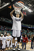 Kathleen Sheer cuts down the net at the conclusion of the game.This was the Championship game of the 2011 ACC Tournament in Greebsboro on March 6, 2011. Duke beat UNC 81-66. (Photo by Al Drago)