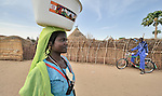 A young woman and her admirer in the Goz Amer refugee camp in eastern Chad. More than a quarter million residents of Darfur live in camps in Chad, along with almost 200,000 Chadians who have been internally displaced by related violence.