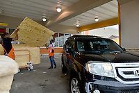 MIRAMAR, FL - OCTOBER 06: Home depot employee helping customer tie they plywood to they car as South Florida residents prepare for Hurricane Matthew by purchasing plywood at Home Depot on October 6, 2016 in Miramar, Florida. The hurricane is expected to make landfall sometime this evening or early in the morning as a possible category 4 storm.Credit: MPI10 / MediaPunch