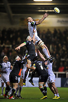 Matt Garvey of Bath Rugby rises high to win lineout ball. Aviva Premiership match, between Newcastle Falcons and Bath Rugby on January 2, 2016 at Kingston Park in Newcastle upon Tyne, England. Photo by: Patrick Khachfe / Onside Images