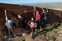 Cantamo, Reggae and Ska band, at the border fence in Tijuana.  ..© Stefan Falke.http://www.stefanfalke.com/..