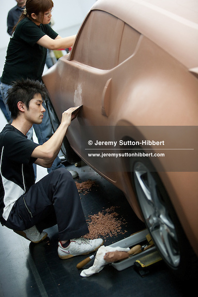 Clay modellers put the finishing touches to a clay production model of the Nissan 'Fairlady Z' car model, Nissan Design Centre, Atsugi, Japan, on Friday 26th March 2010.