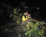 Daniel Ross cuts trees blocking the road on County Road 101 from storm damage in Oxford, Miss. on Wednesday, April 27, 2011.