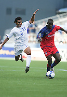 Mariano Acevedo (left) chases after Fabrice Noel (11). Honduras defeated Haiti 1-0 during the First Round of the 2009 CONCACAF Gold Cup at Qwest Field in Seattle, Washington on July 4, 2009.