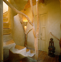 This magical staircase has been constructed from wood, raw plaster and weathered tree trunks
