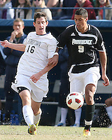 Jimmy Nealis #16 of Georgetown University sends a cross past Marc Cintron #9 of Providence University during a Big East quarter-final  match at North Kehoe Field, Georgetown University on November 6 2010 in Washington D.C. Providence won 2-1.