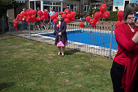 A supporter waits to meet Prime Minister Gordon Brown at a garden party in Weymouth organised by local members of the Labour Party.