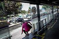 A woman exits illegally and unsafely a station of the massive public transportation know as TRANSMILENIO in Bogota, Colombia.  05/15/2015. Eduardo MunozAlvarez/VIEWpress