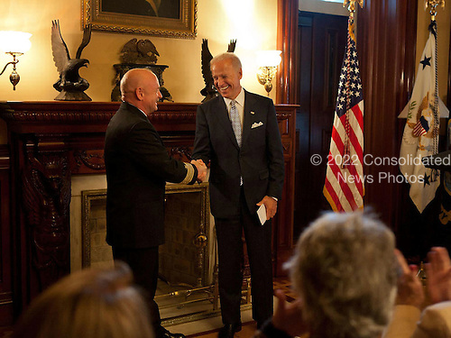 Vice President Joe Biden shakes hands with Captain Mark Kelly during his retirement ceremony in the Secretary of War Suite of the Eisenhower Executive Office Building, in Washington, D.C., October 6, 2011. Kelly was presented the Legion of Merit and the Distinguished Flying Cross medals by the Vice President and Kelly's wife, U.S. Rep. Gabrielle Giffords, for his 25 years of service with the Navy and NASA. .Mandatory Credit: David Lienemann - White House via CNP