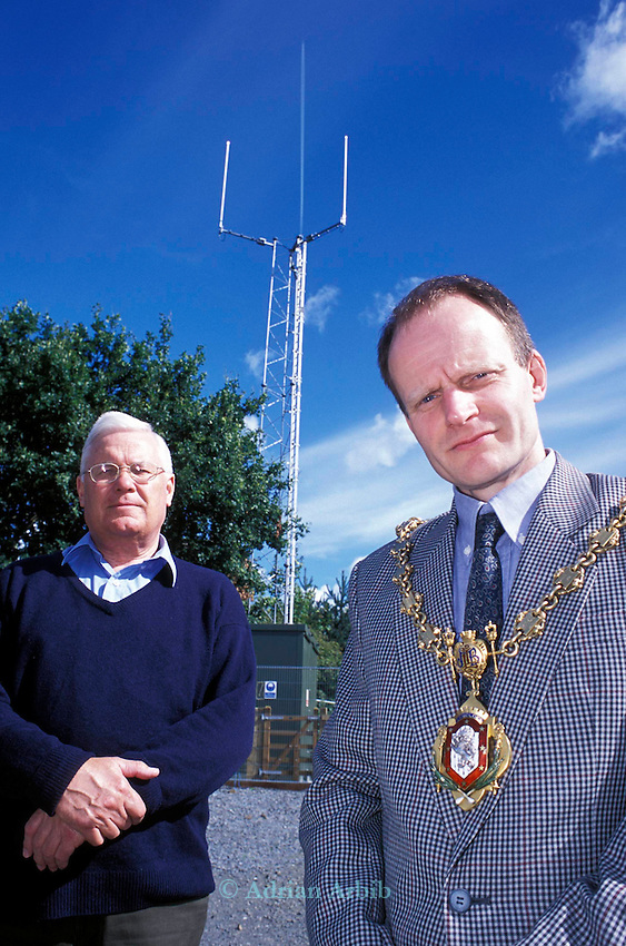 Mayor Edward  Price and  Cllr Gareth Morgan  stand infront of a  Tetra communications  mast  in the  Welsh town of Llanidloes.