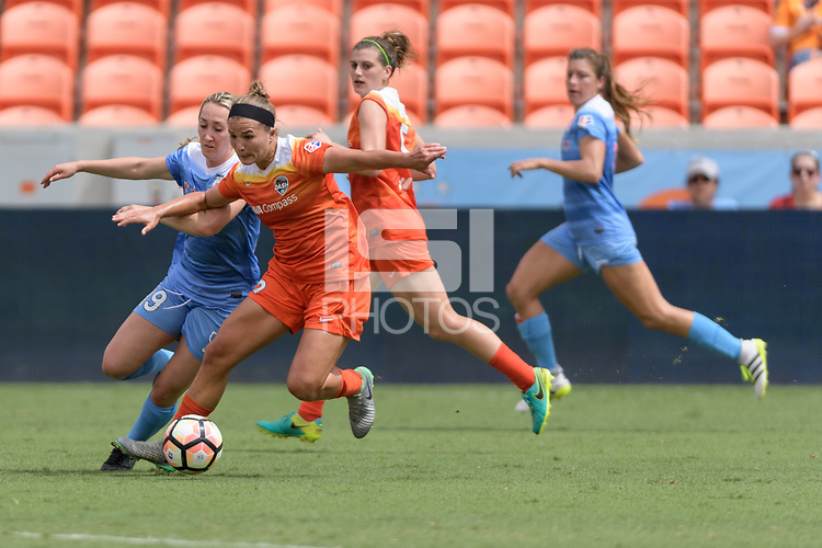 Houston, TX - Saturday April 15, 2017: Summer Green and Amber Brooks battle for control of the ball during a regular season National Women's Soccer League (NWSL) match won by the Houston Dash 2-0 over the Chicago Red Stars at BBVA Compass Stadium.
