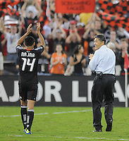 D.C. United midfielder Andy Najar (14) salutes the fans with Executive Chairman William H.C. Chang after the game. D.C. United defeated Real Salt Lake 4-1 at RFK Stadium, Saturday September 24 , 2011.