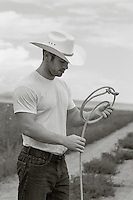 sexy cowboy outdoors on a ranch in New Mexico